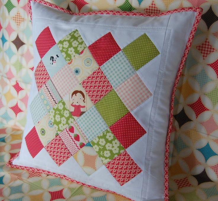 """2 1/2 inch squares and arranging them into colorful Granny Blocks with white border and red trim. It fits a 16"""" pillow."""