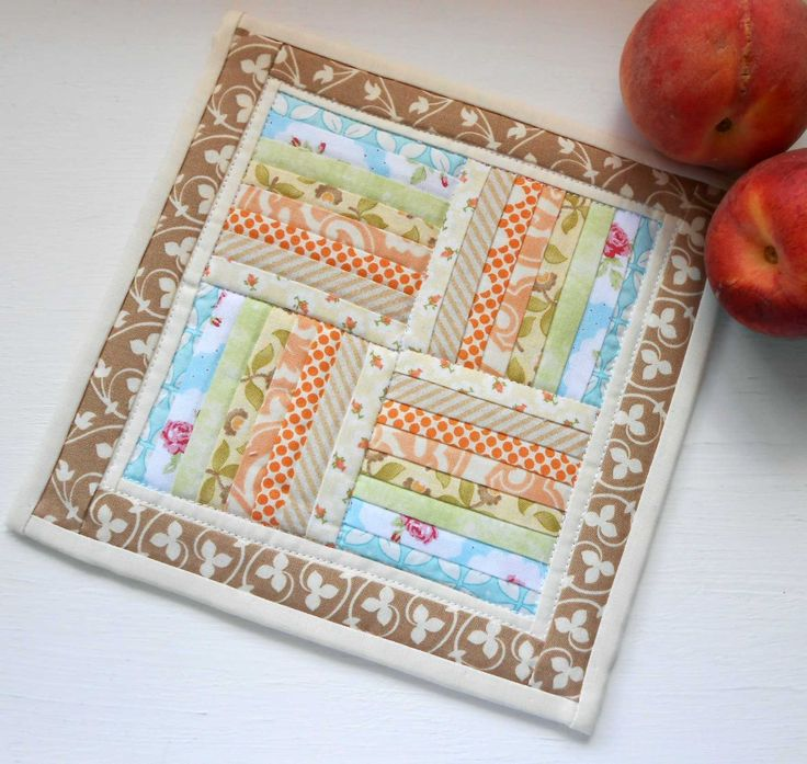 This is my version of the Rail Fence Miniature Quilt from Apple Avenue Quilts.  Free pattern comes in two sizes.
