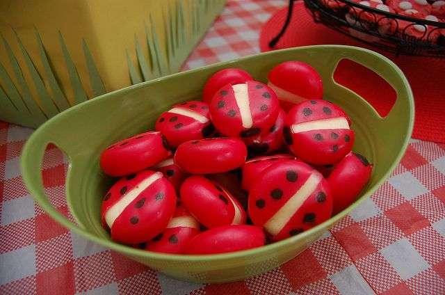 Draw black spots on red-wrapped Babybel cheese rounds to make them look like ladybugs for a healthy snack