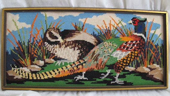Fabulous framed vintage needlepoint pheasant couple. Beautifully done in great autumn colours. Nice large size of about 25 1/2 by 12 1/2 inches to the outside edge of the frame. Thick frame at about 1 1/2 inches thick. Note that this piece was not professionally framed - cardboard