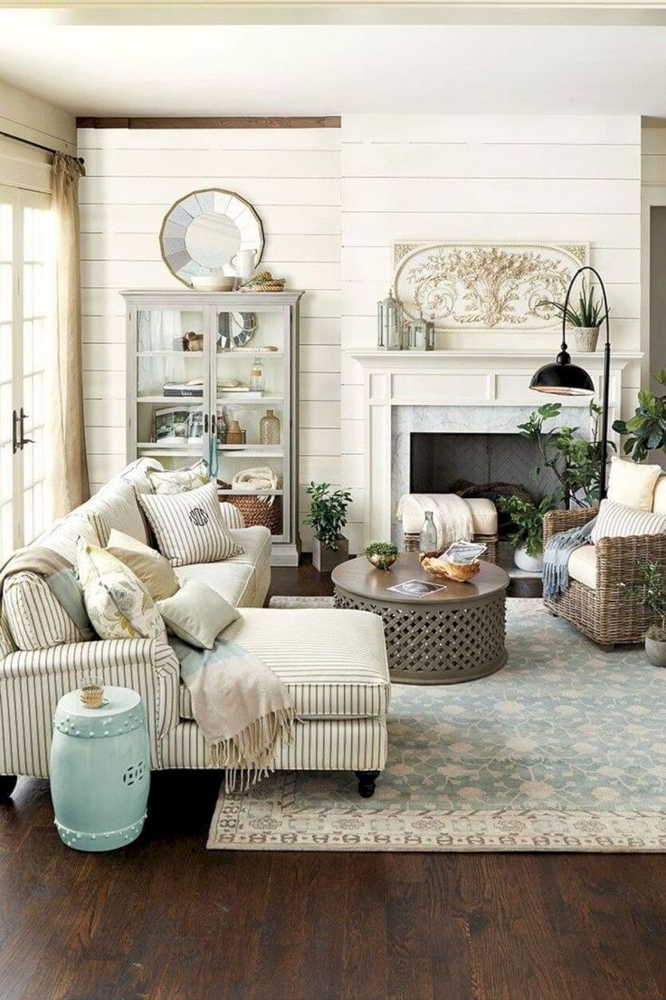 Adorable farmhouse living room with shiplap and pastel accents.