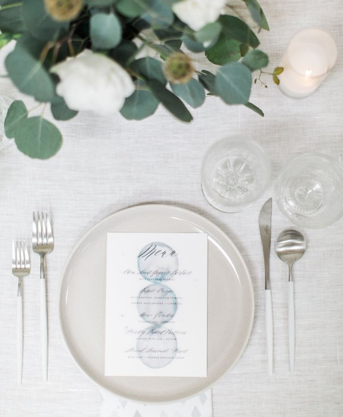 Gray watercolor wedding tablesetting with matching stationery designs.