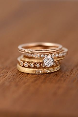 Solitaire with engraved rose gold band, stacked rose gold bands