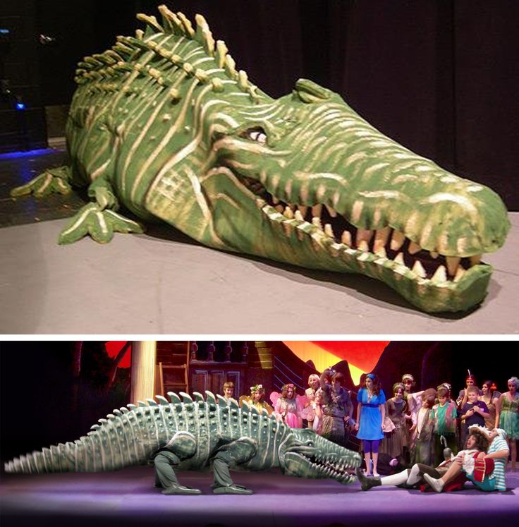 """The crocodile (I named him Ruffles) for """"Peter Pan,"""" for which I used mostly old mattress foam and hot glue. He only needed half a body in his midsection, because he traveled in only one direction onstage. The key to making this giant puppet's human legs look reptilian was to have the actors hunch down and walk backwards instead of knees-forward. (Produced in 2008 by Theater Works, Peoria AZ. Directed by Jim Gradillas.)"""