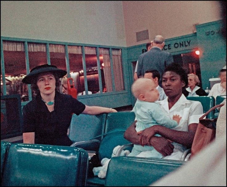 The image is striking: A stone-faced African-American woman in a spotless maid's uniform cradles a white toddler while a stylishly dressed white woman sits nearby. Gordon Parks took the picture at the Atlanta airport in the spring of 1956. (Photo: Gordon Parks)