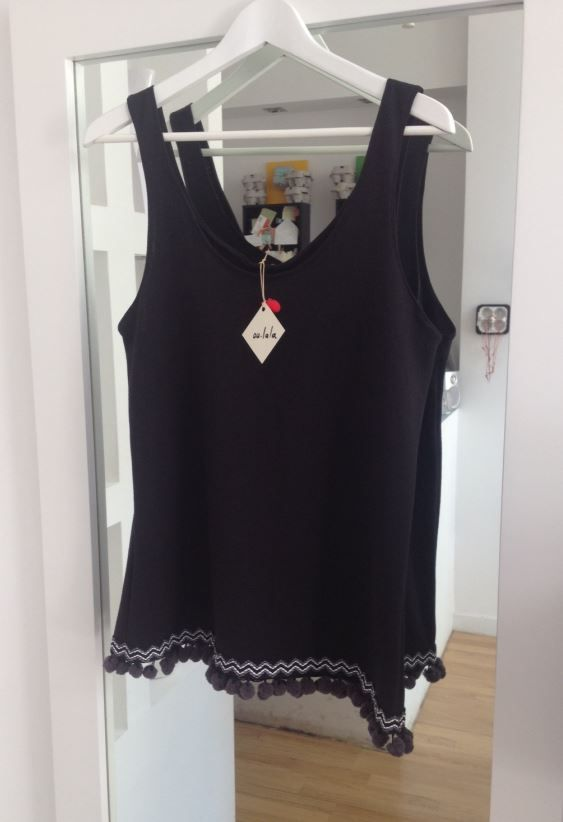 Black vest with Aztec ponpon details - an all year round no brainer!!