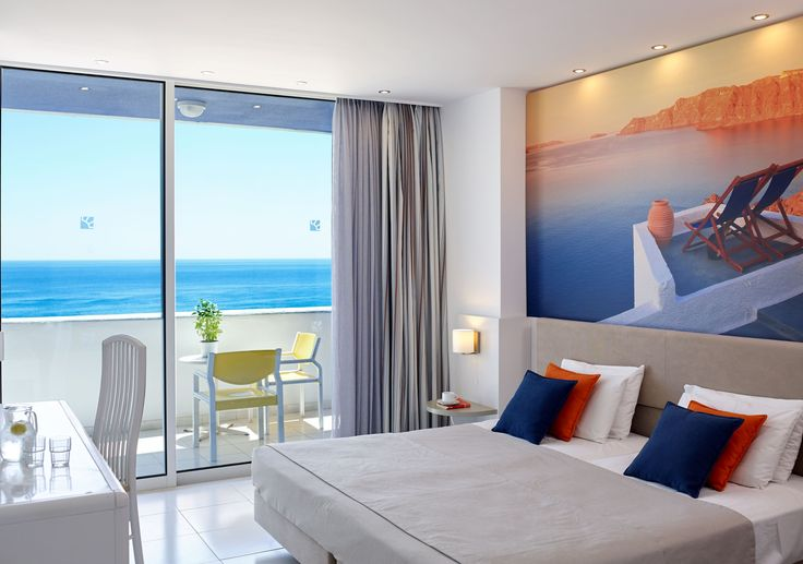 The bedroom and living room have an open balcony with sea views, direct or side view.