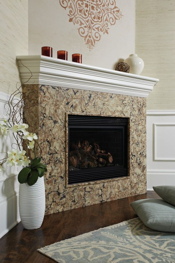 Bradshaw from Cambria's Waterstone Collection used as a fireplace surround. #Cambria #CambriaQuartz #Quartz