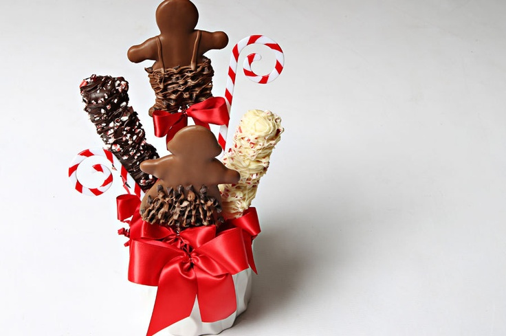 Holiday Cookie Bouquet  This festive chocolate arrangement is beautiful and delicious. Filled with chocolate covered cookies and marshmallows, this gift will bring joy to all.