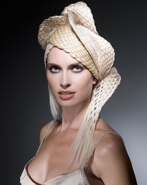A long blonde straight plaited plaits quirky avant garde hairstyle by Steven Carey
