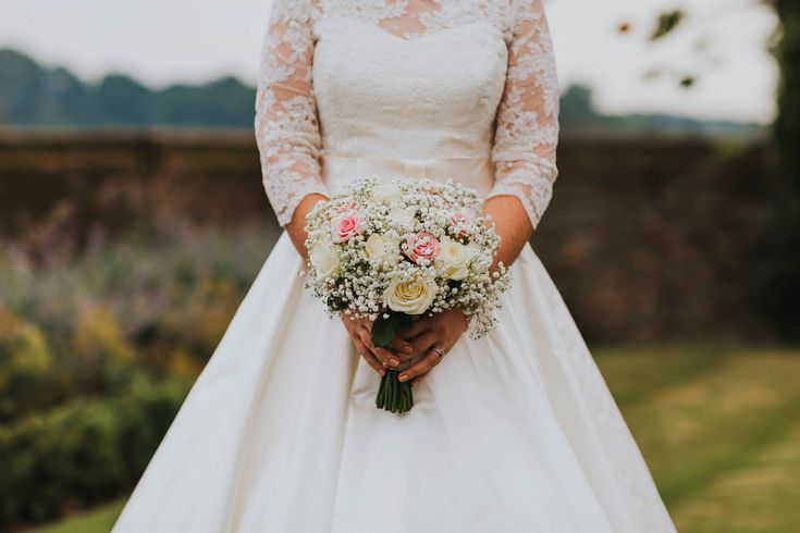 Roses and baby's breath are a lovely combination for bouquets. Photo by Benjamin Stuart Photography #weddingphotography #bridalbouquet #weddingflowers #bride #flowers #weddingdress