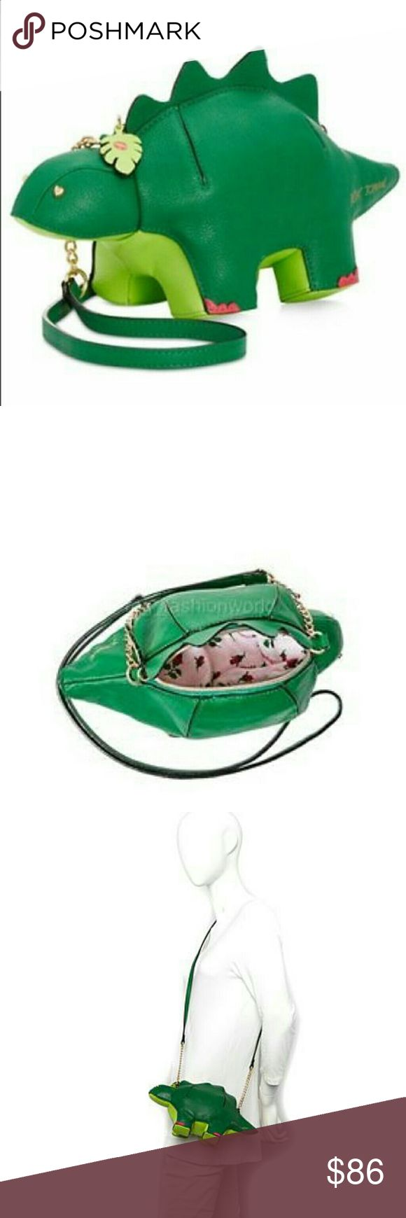 """🎁Betsy Johnson Dinosaur crossbody This little guy holds just enough of your stuff to get you through your day or night.  Stegosaurus shaped silhouetteTextured faux leather Gold tone hardware, including heart shaped stud eyes Top Zipper closure, with green """"LEAF"""" shaped zipper pull Green leaf has a Betsey """"kiss"""" print in fuchsia on one side Structured, stands on it's own. Measurements 6""""Hx12""""Lx5""""D Partial chain strap 23"""" drop  Please don't comment about pricing in my listing, I'd much rather…"""