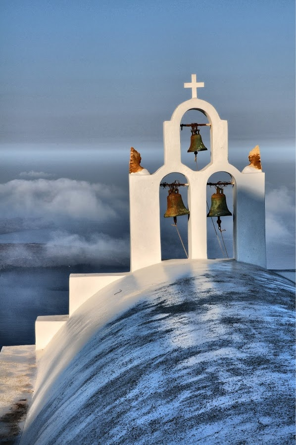 Santorini is famous for the blue domed & colorful chirches. Religious tourism in Santorini