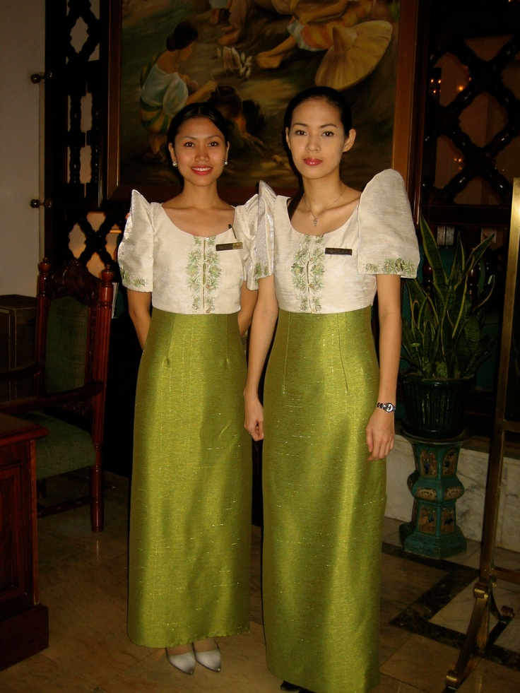 Beautiful Ladies At The Manila Hotel Wearing The Classic