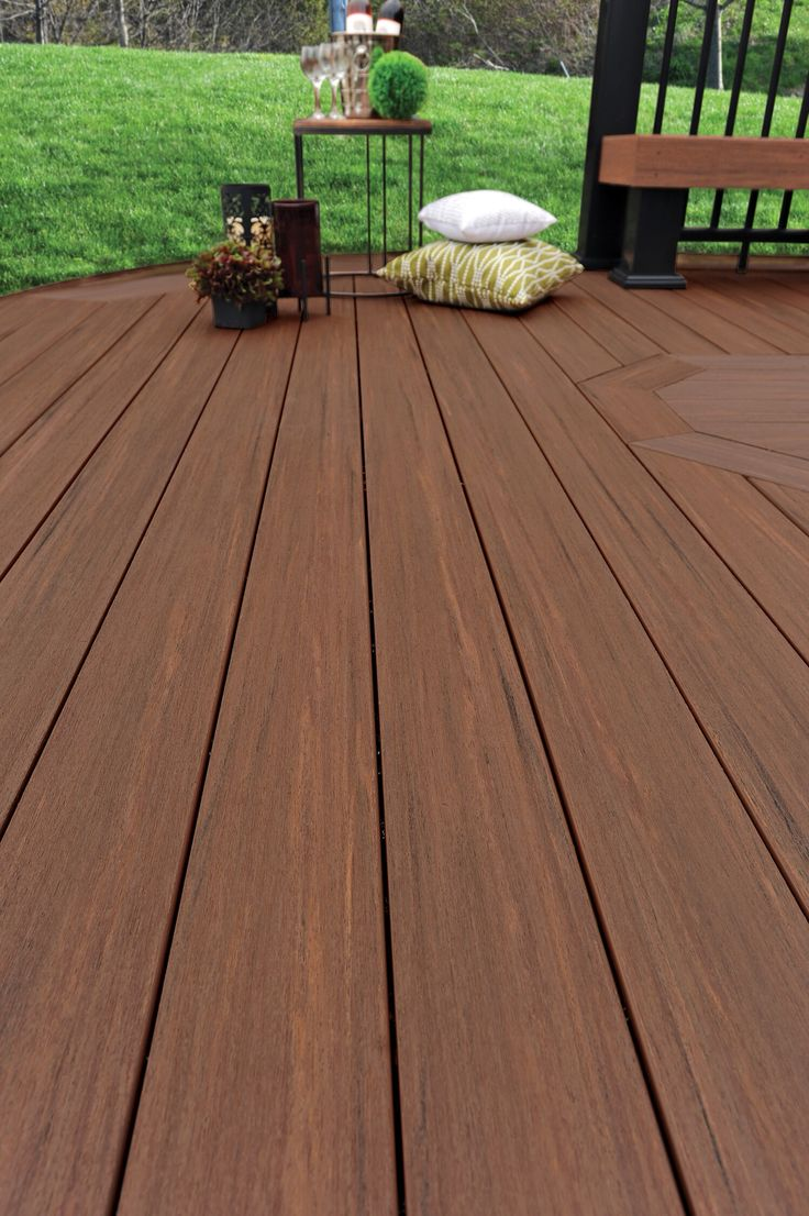 AZEK Deck's Vintage Collection features a rustics texture found in indoor flooring and rich colors with dramatic streaking that look like tropical hardwoods. Shown here, Mahogany, really brings low maintenance decking to life. #deck #azek #lowmaintenance