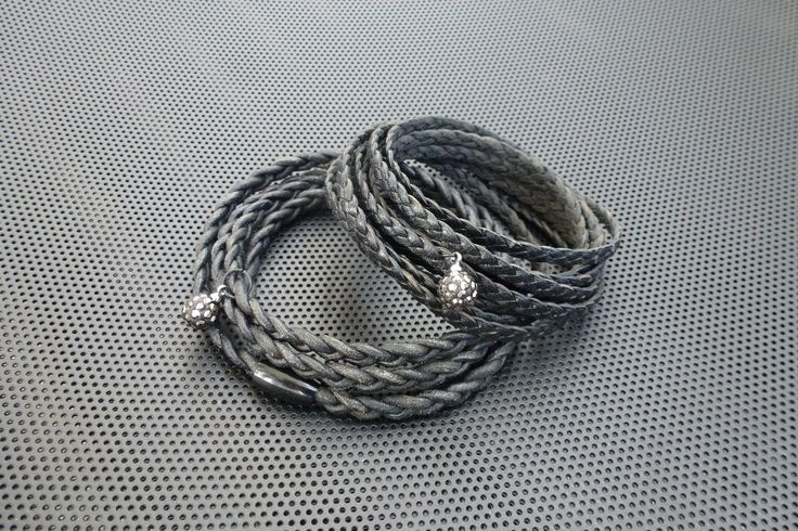 Bracelets,wrap(var.braided leather,magnetic closure,rhinestone bead)Made by UNNI HOFF