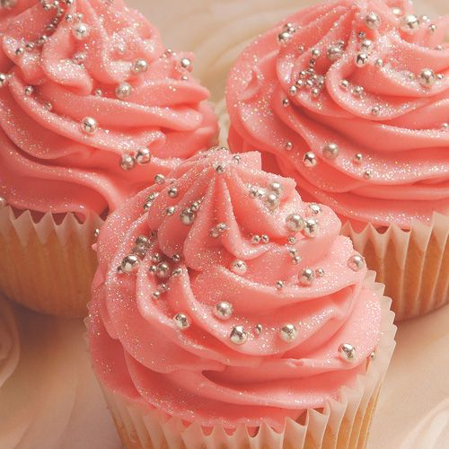 Salmon colored frosted cupcakes with silver edible glitter dust & silver edible balls
