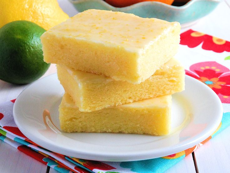 """Fudgy, lemony and irresistible. The texture of these Best Ever Lemon Brownie Bars is very similar to brownies and the glaze is like pure sunshine. Perfect for summer entertaining and picnics. Recipe includes an equally irresistible gluten free option. A Ray of Sunshine in Bar Form: Best Ever Lemon """"Brownie"""" Bars Friends, get your pucker on! For some serious lemony goodness. Have you seen my Lemon Love board over at Pinterest? As one of my sweet followers commented, it is seriously out of…"""