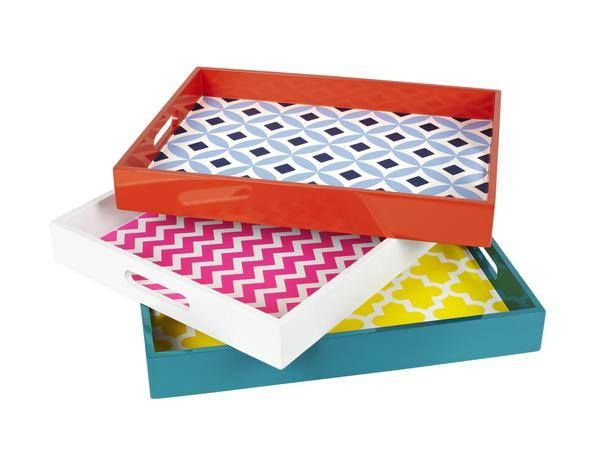 Use contact paper or wallpaper to decorate the inside of a boring tray.