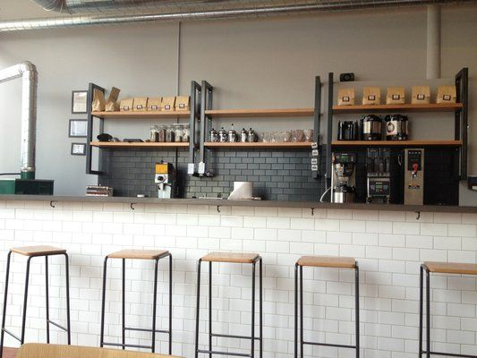 Photos for Big Shoulders Coffee | Yelp -- white subway tile on bar, grey on ktichen, hooks underneath bar!