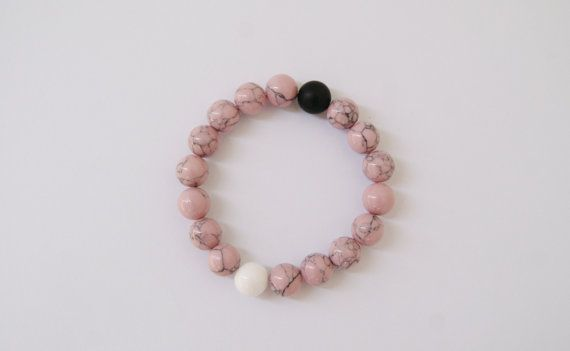 Handmade bracelet made from natural stones pink marble howlite white jadeite mat black onyx balance beaded live lokai accessories