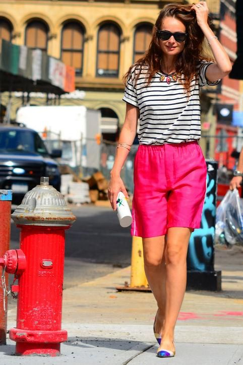 Human Again in hot pink shorts and a striped top