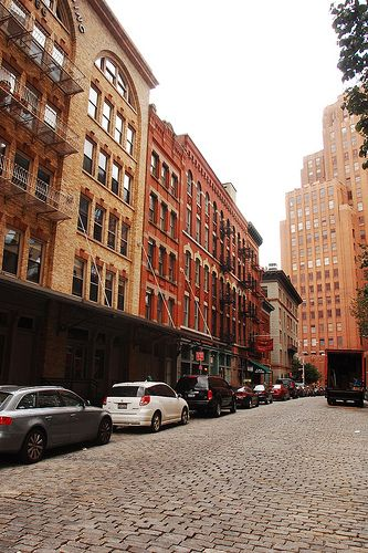 NEW YORK CITY manhattan NEW YORK NY Building buildings street streets meat packing district dog bicycle staple street