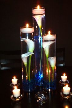 calla lily submerged in water centerpiece - Google Search                                                                                                                                                                                 More