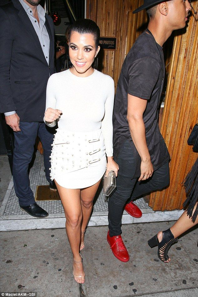 Bright-eyed: Kourtney looked full of vitality as she smiled for the cameras...