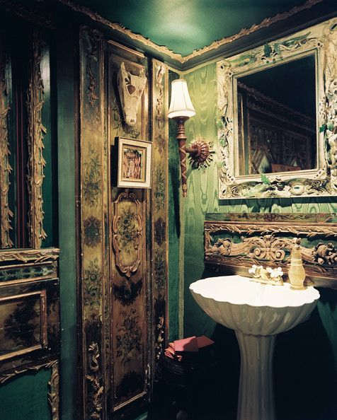 A powder room with walls upholstered in green silk moire by  Tony Duquette /Hutton Wilkinson, Lonny September 2012 Issue