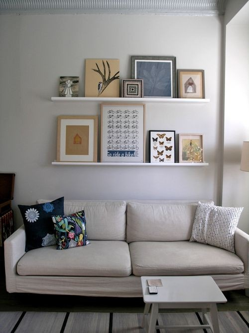 Pictures resting in shelves!  Can be rearranged so easily!  Love this idea.