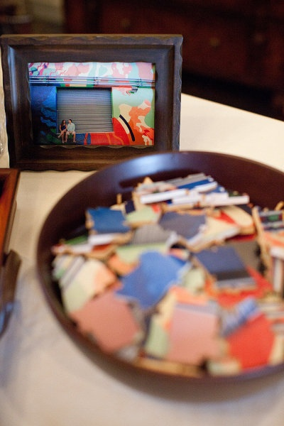 in lieu of a guestbook, guests sign pieces of a picture puzzle of the couple