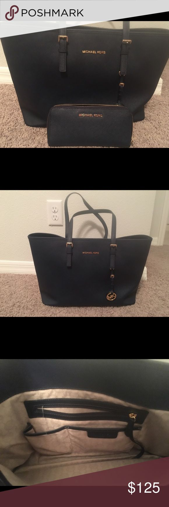 "Michael Kors Jet Set Travel Tote - Navy Leather; lining polyester 18""W 10.5""H 6""D 1 zip pocket in middle, 3 slip pockets, cell phone pocket, and key finder. 9""L double handles Michael Kors Bags Totes"