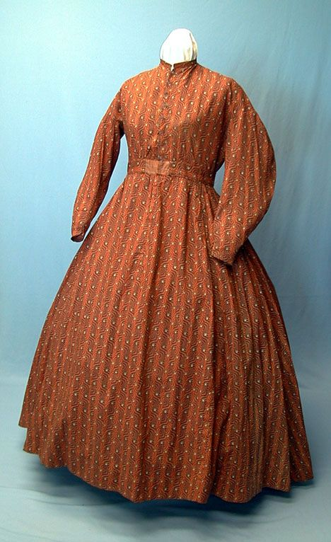 Calico Work Dress, 1860s View More Civil War Era cotton work/day dress. This one piece dress is entirely hand sewn from a fabulous calico print in warm reds, oranges and browns; see close-up photos for details. This dress features dropped shoulders and one piece military style sleeves with wide elbows and narrow wrists but is not piped anywhere.