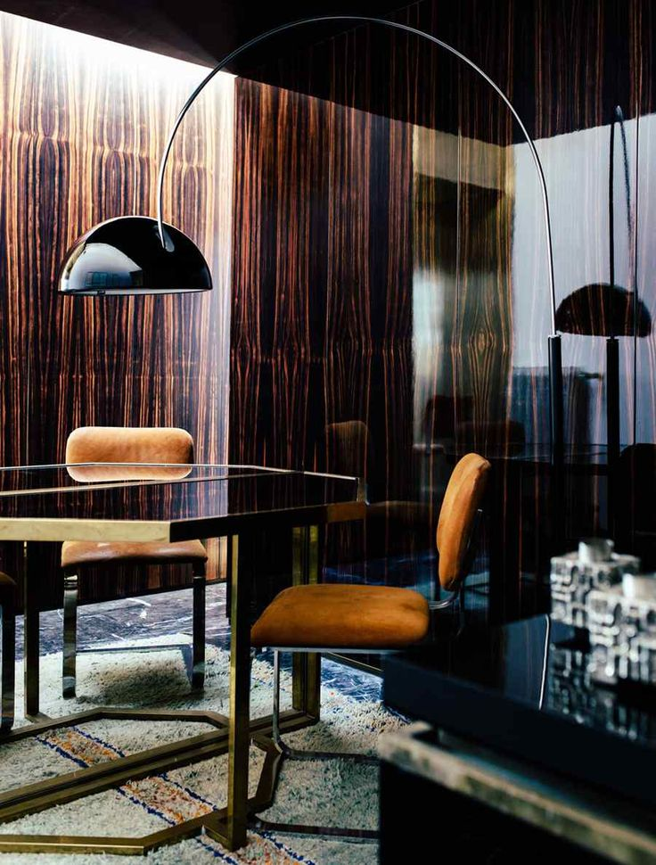 The Home Of Italian Architect Massimo Adario Has A Very Warm Dark Masculine Feel There Is Certainly Richness Materials Displaying Assortment