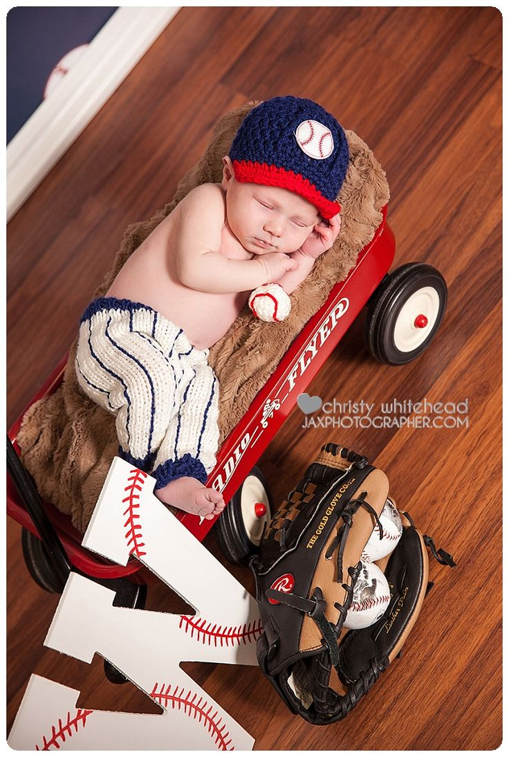 Cute little baseball themed newborn session. I have the baseball outfit, little baseball, wagon and backdrop in studio. North Florida/Jacksonville photographer Christy Whitehead Photography www.ChristyWhitehead.com