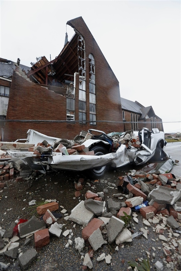 Assessing the tornado damage in Hattiesburg, Mississippi (Photo: Rogelio V. Solis / AP)
