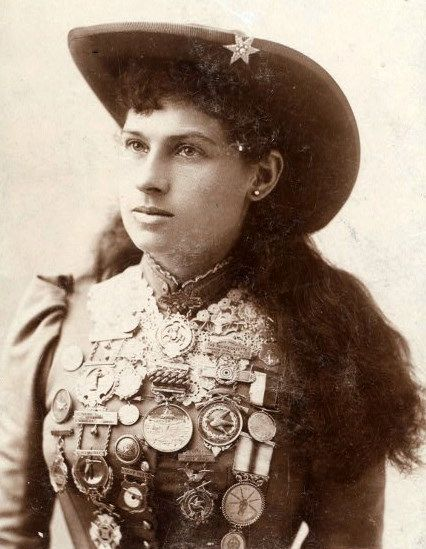 Annie Oakley  was an American sharpshooter and exhibition shooter. Oakley's amazing talent and timely rise to fame led to a starring role in Buffalo Bill's Wild West show, which propelled her to become the first American female superstar.    Using a .22 caliber rifle at 90 feet Oakley reputedly could split a playing card edge-on and put five or six more holes in it before it touched the ground.