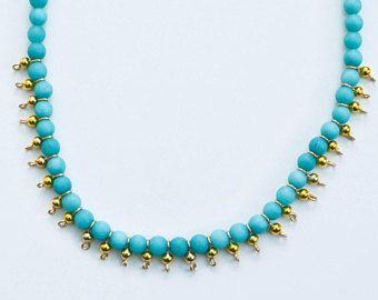 Turquoise Choker with Gold details