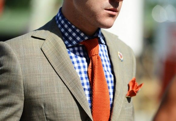 orange knitted tie, blue gingham shirt