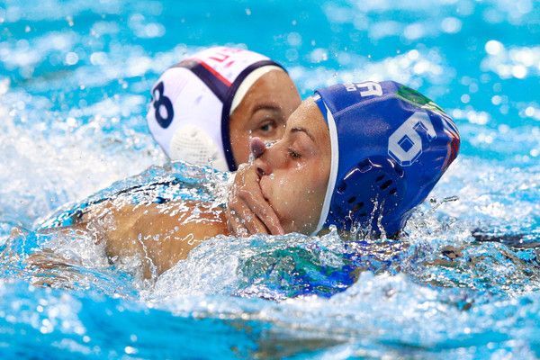 Kiley Neushul #8 of United States and Rosaria Aiello #6 of Italy compete in the Women's Water Polo Gold Medal Classification match between the United States and Italy on Day 14 of the Rio 2016 Olympic Games at the Olympic Aquatics Stadium on August 19, 2016 in Rio de Janeiro, Brazil.