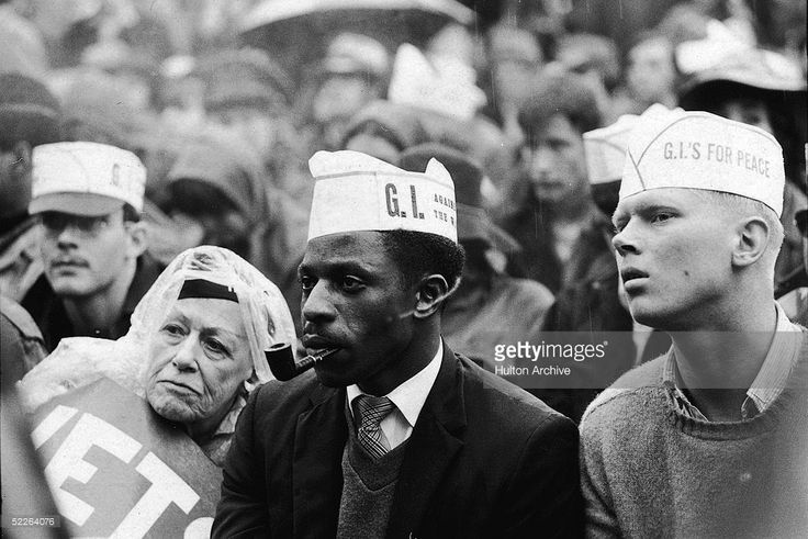 Young men wearing 'GIs For Peace' hats and other protestors listen attentively to a speaker as they gather outside the 1968 Democratic National Convention to protest the Vietnam War, Chicago, Illinois, August 1968.