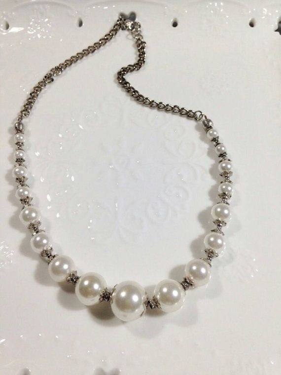 Check out this item in my Etsy shop https://www.etsy.com/listing/228926982/shell-pearls-necklace-with-silver-chain
