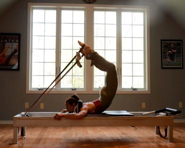 Kathi Ross Nash is demonstrating the Scorpion on the reformer #pilates#fit#strength