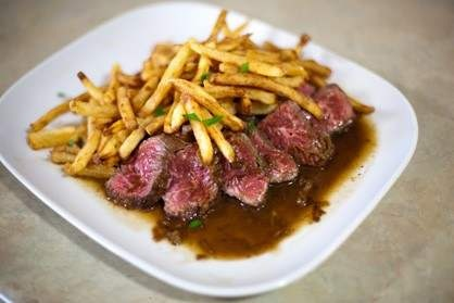 ... HANGER STEAK WITH HOMEMADE POMMES FRITES AND A SHALLOT DEMI-GLACE PAN