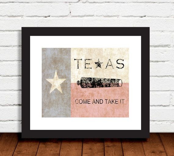The Texas flag forms the background for this popular and patriotic Texas slogan at the Battle of Gonzales.
