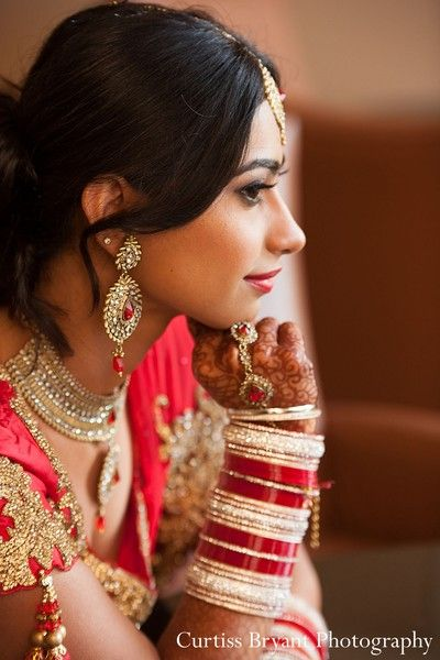 This Indian bride poses for beautiful wedding portraits.