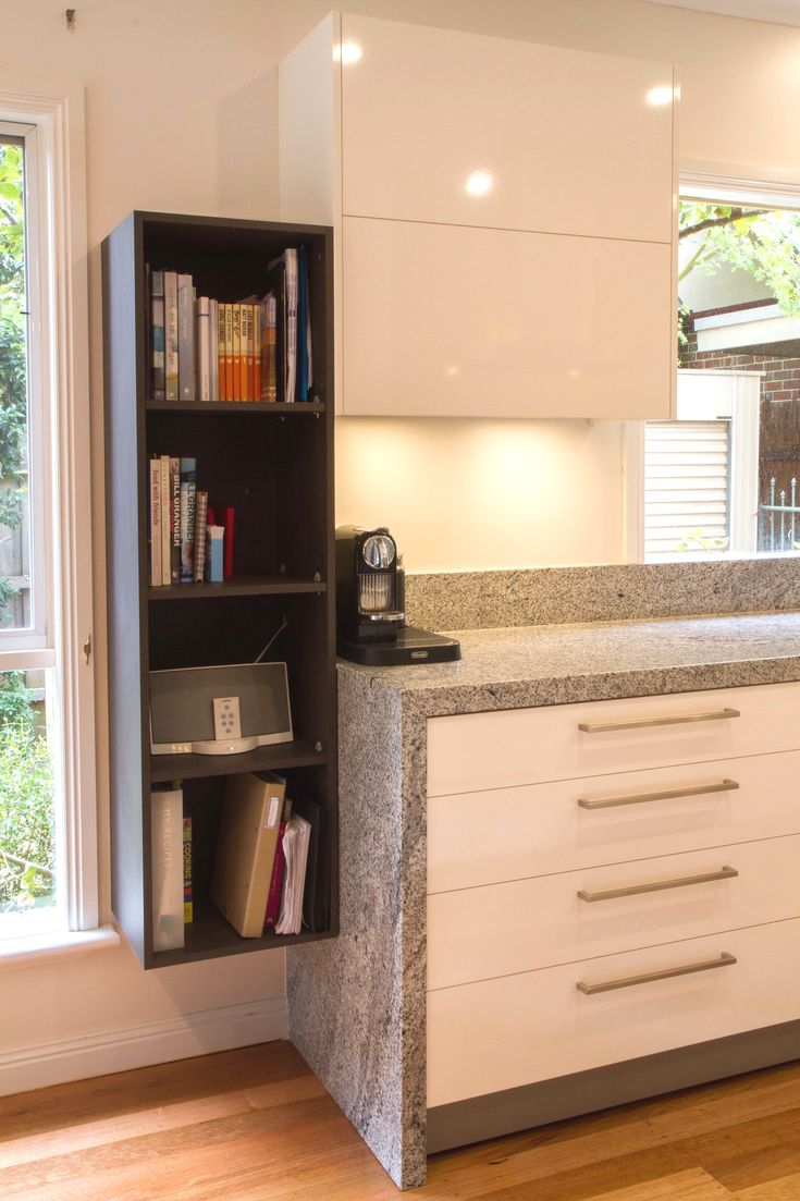 Floating shelves for cookbooks and speakers. www.thekitchendesigncentre.com.au