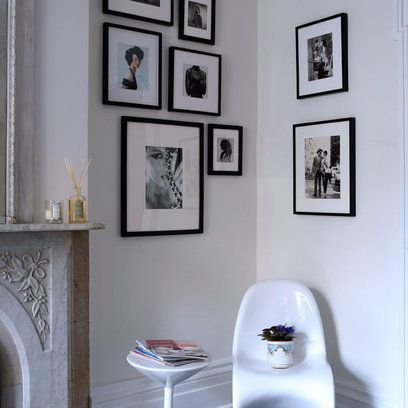 Create a corner feature by visually connecting two adjoining walls with similarly framed pictures. Keep to the same style and colour to increase the cohesion of the look.