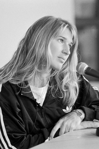 Steffi Graf meets with reporters at a post-match press conference in the 1990's. Nine times out of ten Steffi was asked how she won the match!